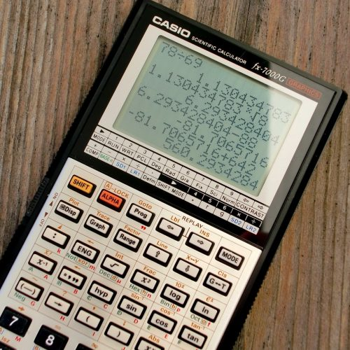black-and-grey-casio-scientific-calculator-showing-formula-220301